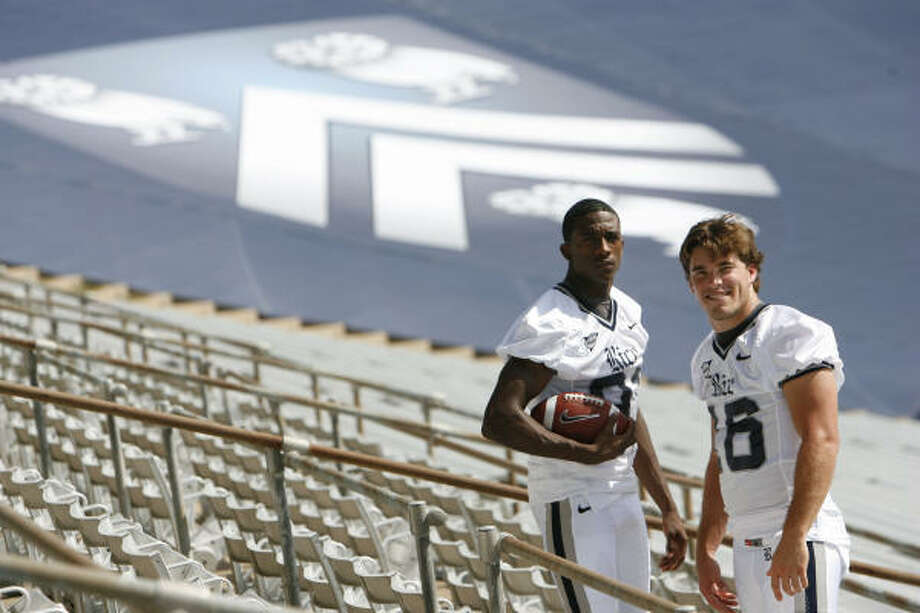 Wide receiver Jarett Dillard, left, and quarterback Chase Clement at Rice Stadium on Aug. 2, 2008. That year, Dillard caught 87 passes, 20 of them for touchdowns and Clement threw for 4,119 yards and 44 scores, leading the Owls to a 10-3 season and a win in the Texas Bowl over Western Michigan. Photo: Sharon Steinmann, Chronicle