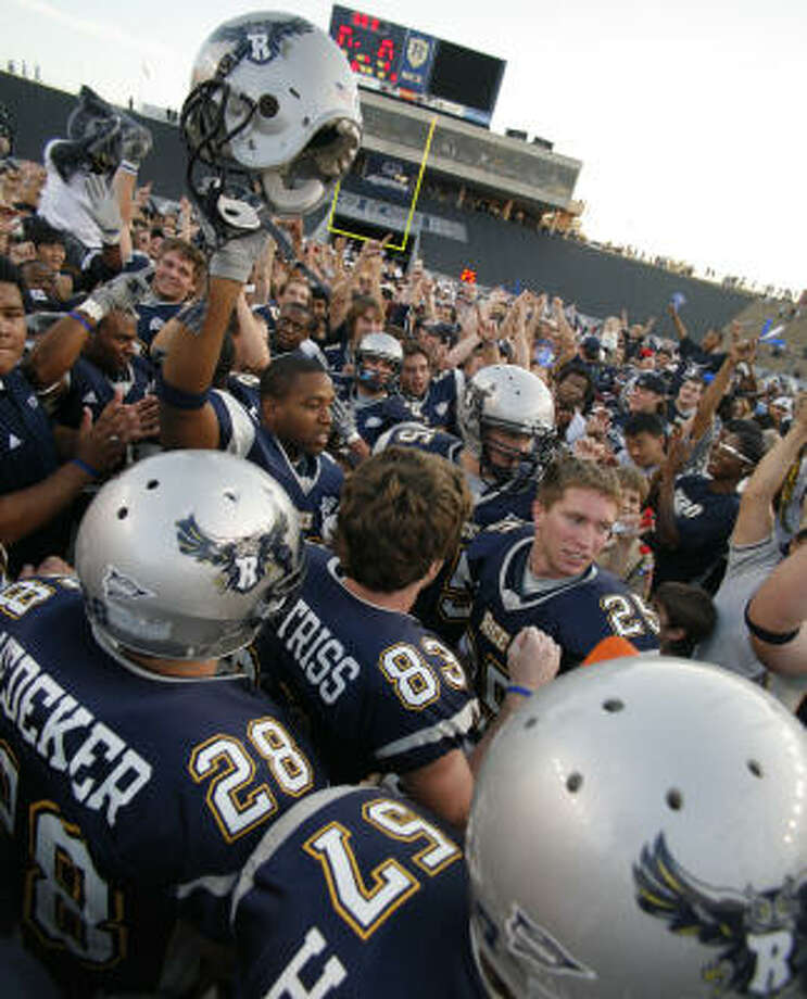 Players and fans celebrate as Rice beats SMU 31-27 on Nov. 25, 2006. With the win, the Owls assured themselves of their first bowl-game appearance since 1961. Photo: Steve Ueckert, Chronicle
