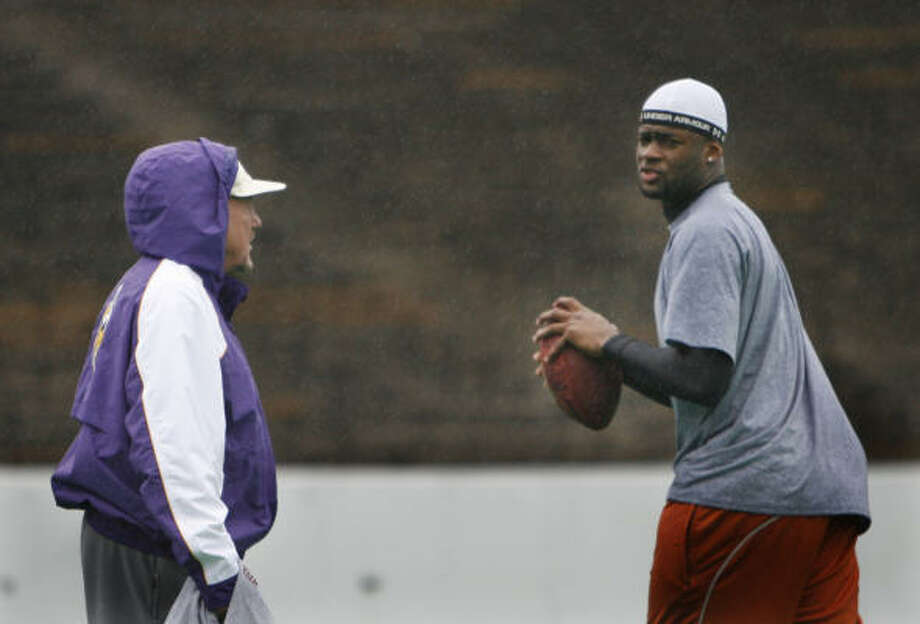 Former University of Texas quarterback and Houston native Vince Young used Rice Stadium on Feb. 18, 2006, to prepare for the NFL combine. Young worked out on a rainy Saturday morning under the watchful eye of former NFL quarterback coach Jerry Rhome. Photo: Steve Ueckert, Chronicle