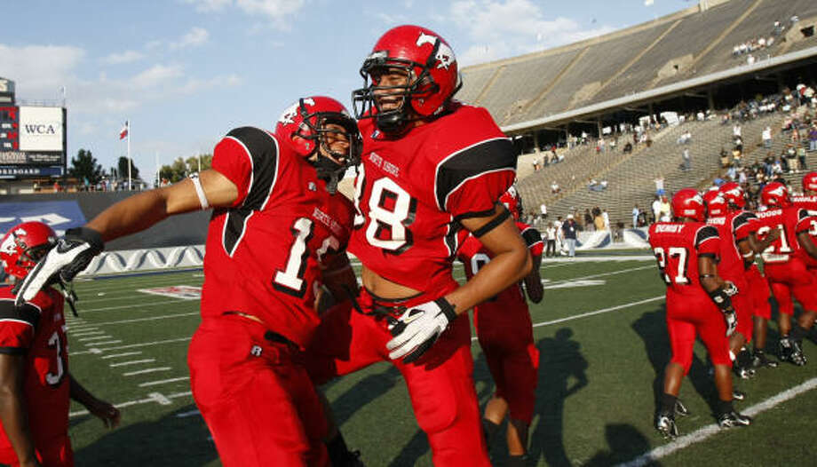 Rice Stadium has also hosted plenty of high school football. Here, North Shore's Ronnie Groves, left, and William Cooper celebrate after beating Hightower on Dec. 8, 2007. Photo: Nick De La Torre, Chronicle