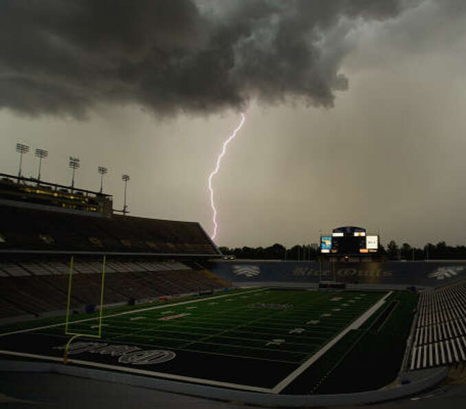 Lightning strikes near Rice Stadium on Aug. 21, 2009. In 2008, a new scoreboard complex with a video