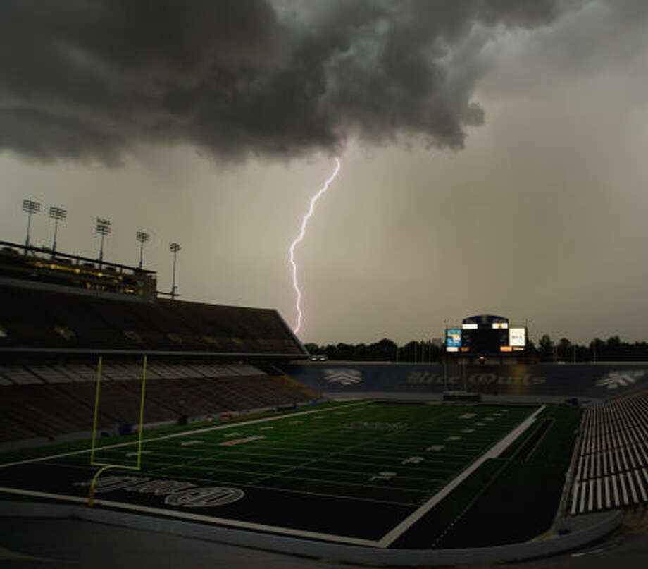 Lightning strikes near Rice Stadium on Aug. 21, 2009. In 2008, a new scoreboard complex with a video board and enhanced information was constructed above the north end zone. Photo: Bob Levey, For The Chronicle