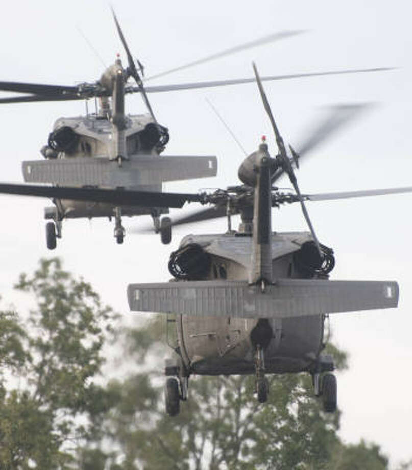 Rice Stadium contributed to the relief effort after Hurricane Ike. Here, a pair of Black Hawk helicopters depart the stadium parking lot on Sept. 14, 2008, after being met by ambulances to take patients to the Texas Medical Center in the aftermath of the devastating storm. Photo: Steve Ueckert, Houston Chronicle