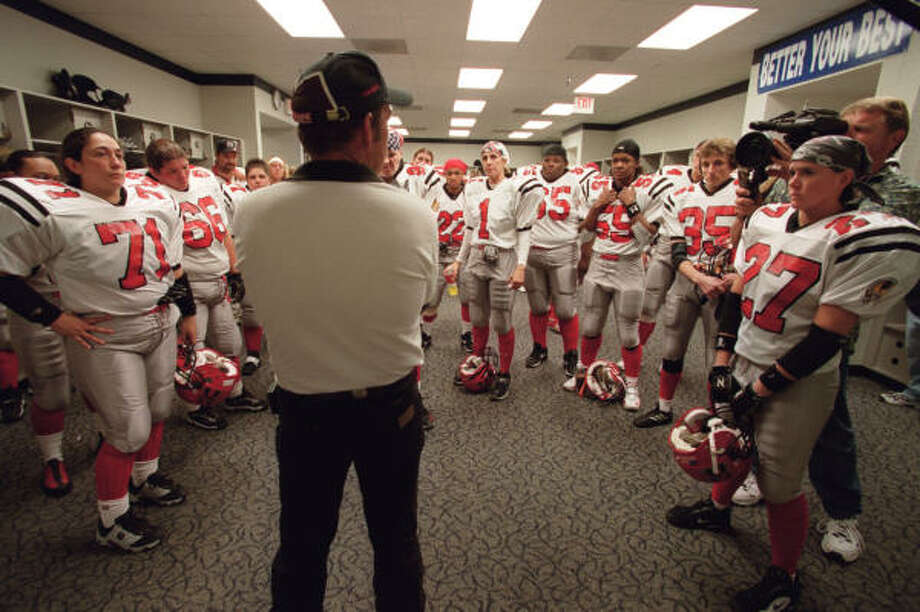 Women's football? Yes, Rice Stadium has seen that, too. Here, Houston Energy players listen to head coach Robin Henry before taking the field against Dallas on Oct. 12, 2002. Photo: D Fahleson, Houston Chronicle