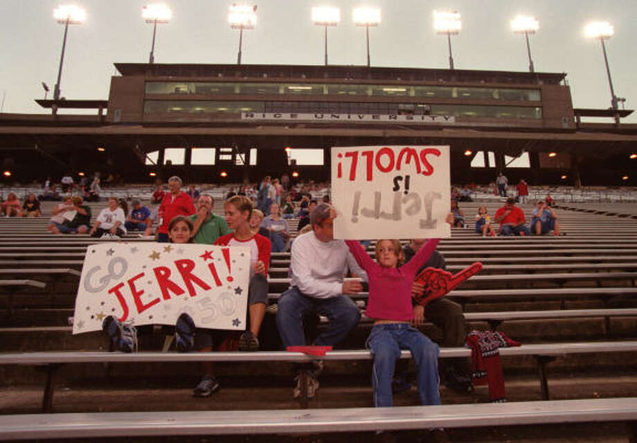 Katie Whitehead, with sign at left, and Erin Farris, with upside-down sign, support the Houston Energy against Dallas. The Energy were two-time national champs of women's pro football. Photo: D Fahleson, Houston Chronicle