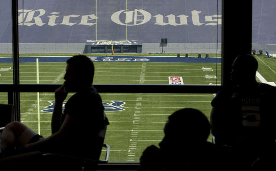 Rice players listen to head coach David Bailiff on Aug. 7, 2010.