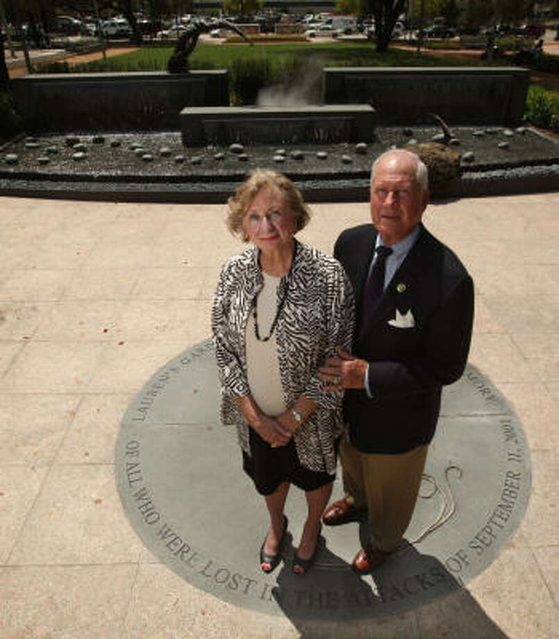 Barbara and Larry Catuzzi on Friday toured the garden at Market Square Park named in honor of their daughter, Lauren Catuzzi Grandcolas, who died aboard United Airlines Flight 93. Photo: Mayra Beltran, Chronicle