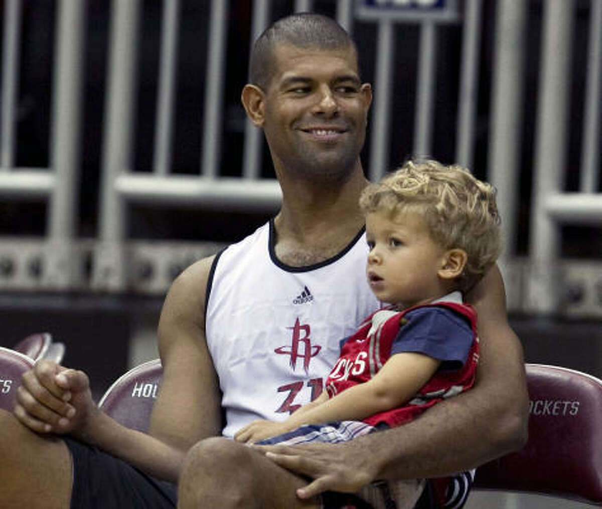 Rockets forward Shane Battier has his two-year-old son Zeke at practice.