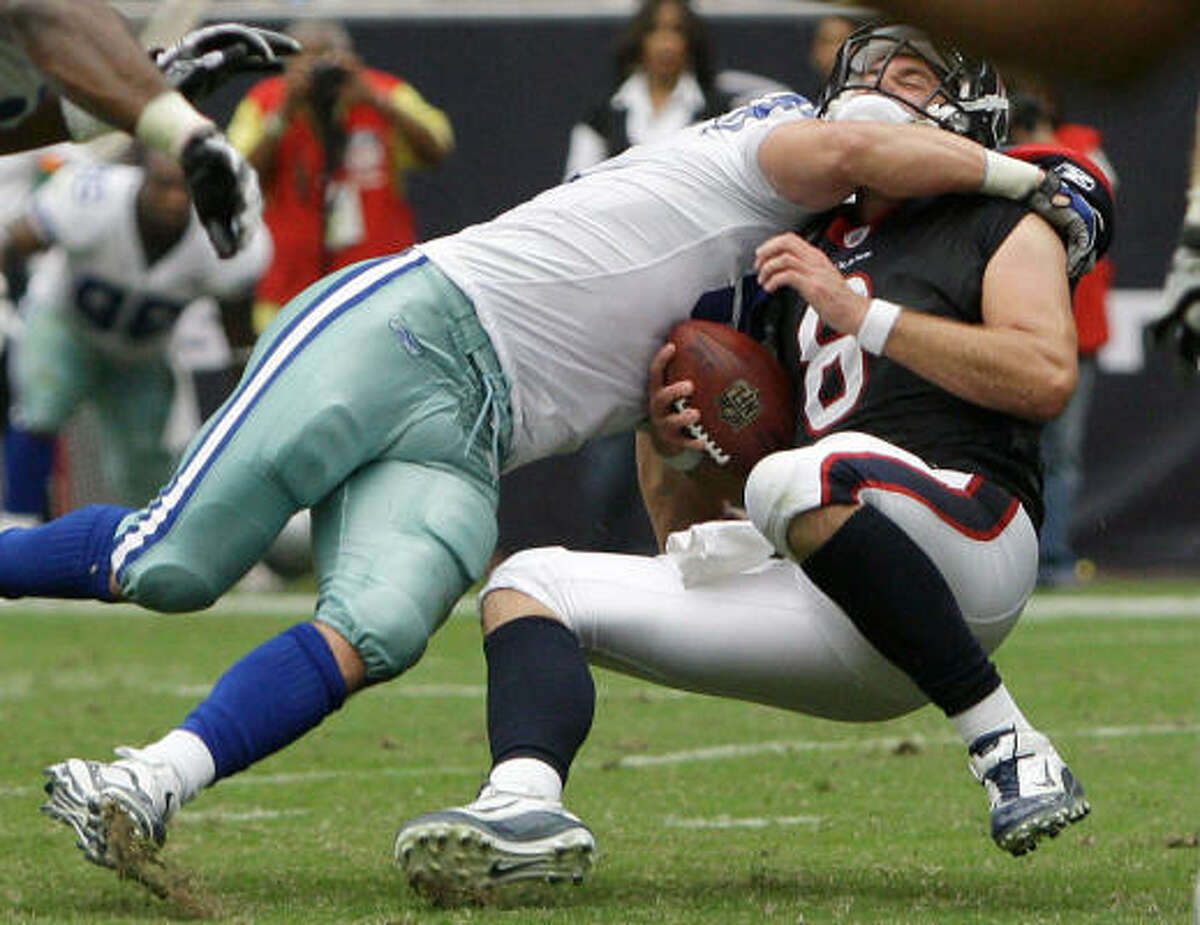 Sept. 26: Cowboys 27, Texans 13 Texans quarterback Matt Schaub gets sacked by Cowboys linebacker Keith Brooking during the fourth quarter.