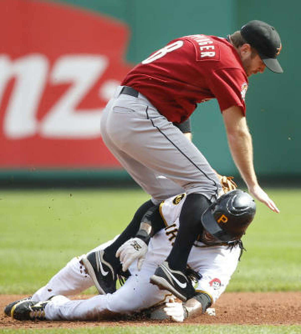 The Pirates' Andrew McCutchen, bottom, slides into Astros second baseman Jeff Keppinger as he is forced out on a ground ball by Jose Tabata in the first inning.