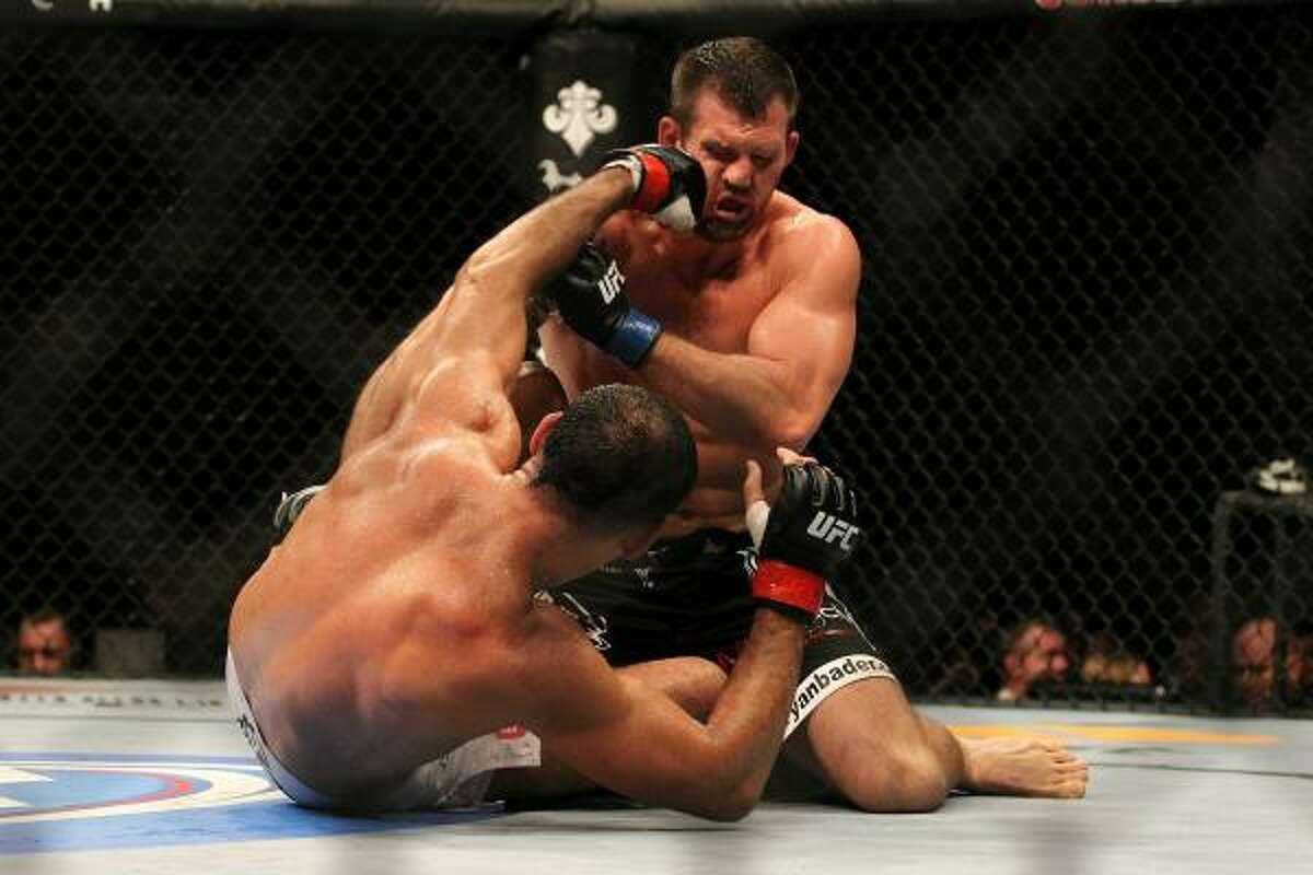 Ryan Bader, top, is punched by Rogerio Nogueira during their UFC light heavyweight bout.