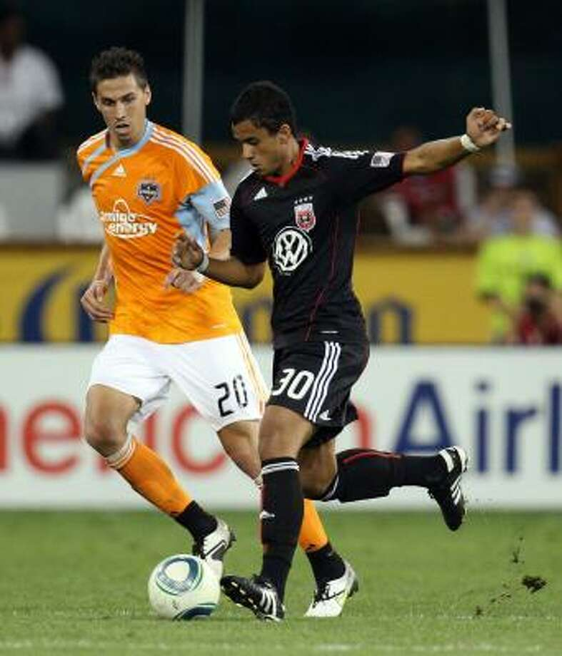 Junior Carreiro of D.C. United controls the ball against Geoff Cameron of the Dynamo. Photo: Ned Dishman, Getty Images