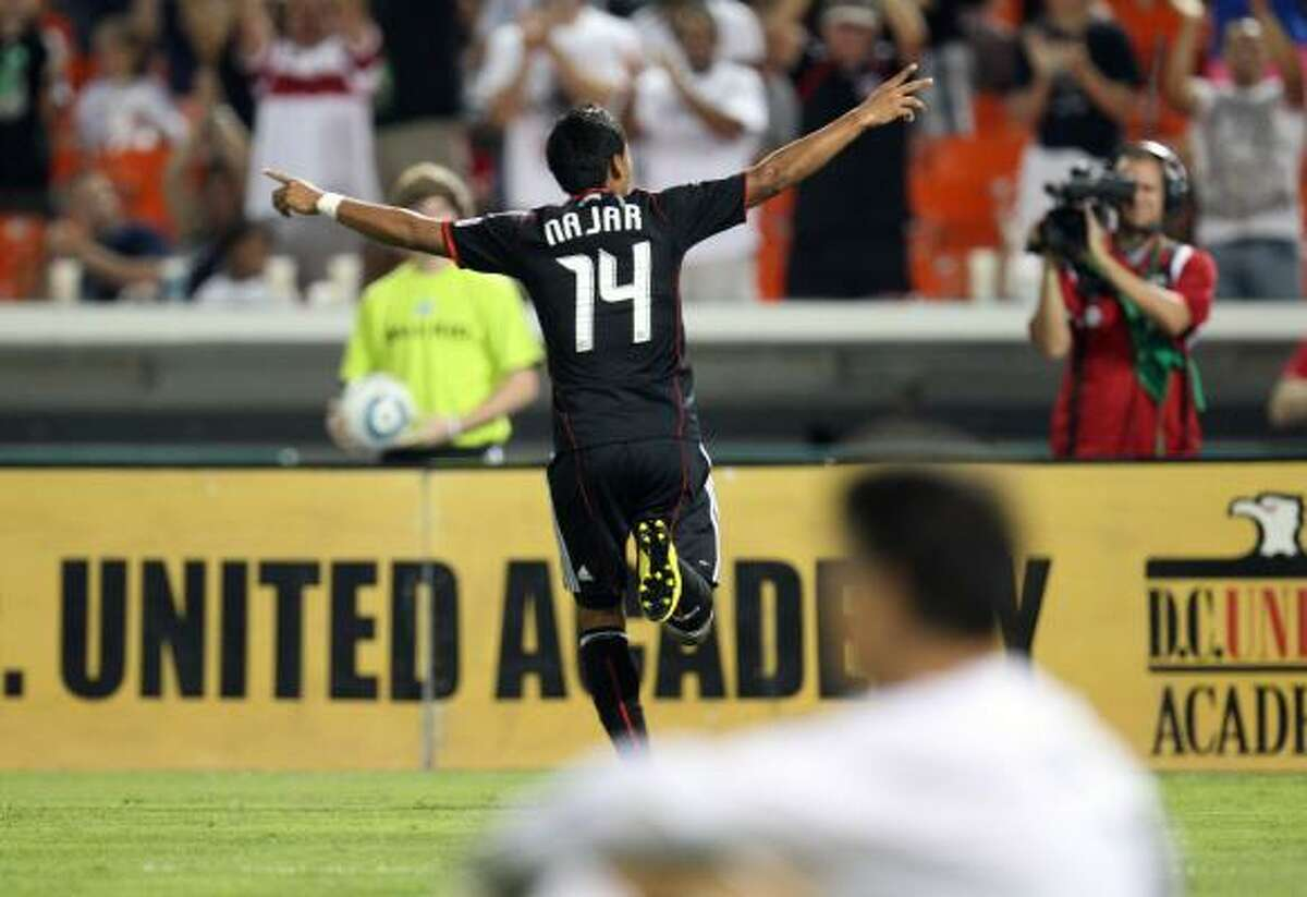 Andy Najar of D.C. United celebrates after a goal against the Dynamo.
