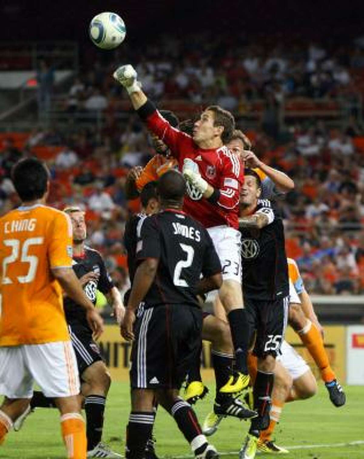 Troy Perkins of D.C. United punches the ball away.