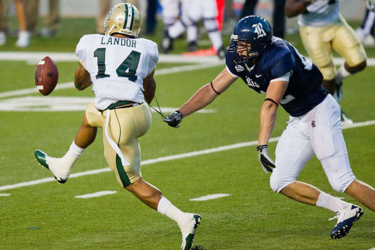 Sept. 25: Baylor 30, Rice 13 Baylor Bears safety Byron Landor (14) nearly intercepts a pass intended for Rice Owls tight end Luke Willson (82) during the first half.