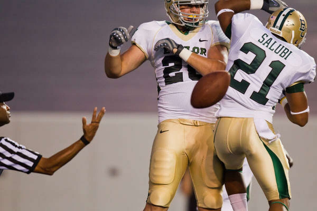 Baylor Bears tight end Jerod Monk (20) celebrates with running back Jarred Salubi (21) after scoring a touchdown during the first half.
