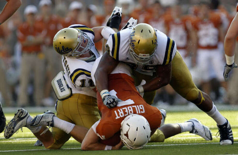 Sept. 25: UCLA 34, Texas 12Texas' Garrett Gilbert (7) is tackled by UCLA's Sean Westgate (11) and Nate Chandler (89) during the second half. Photo: VERNON BRYANT/Staff Photographer