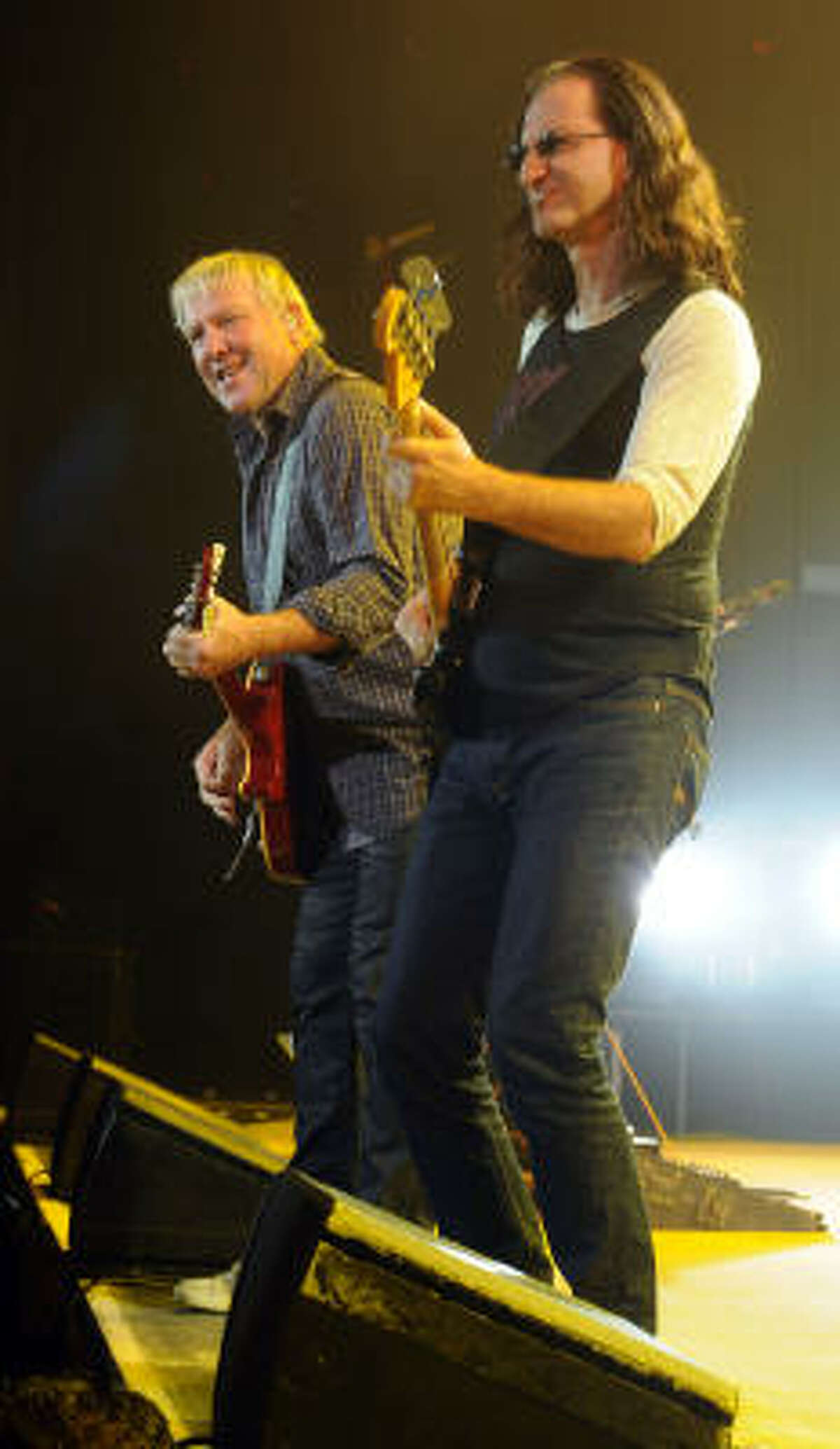 Alex Lifeson and Geddy Lee of Rush performs at the Cynthia Woods Mitchell Pavilion in The Woodlands Saturday Sept. 25, 2010.