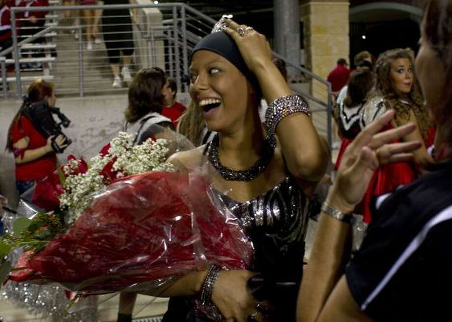 Devin Duncan, 17, a senior at Langham Creek High School, who is currently receiving treatment for leukemia for a second time after surviving the disease when she was three, was crowned the homecoming queen during the halftime of the football game at the Berry Stadium in Cypress. Photo: Johnny Hanson, Houston Chronicle