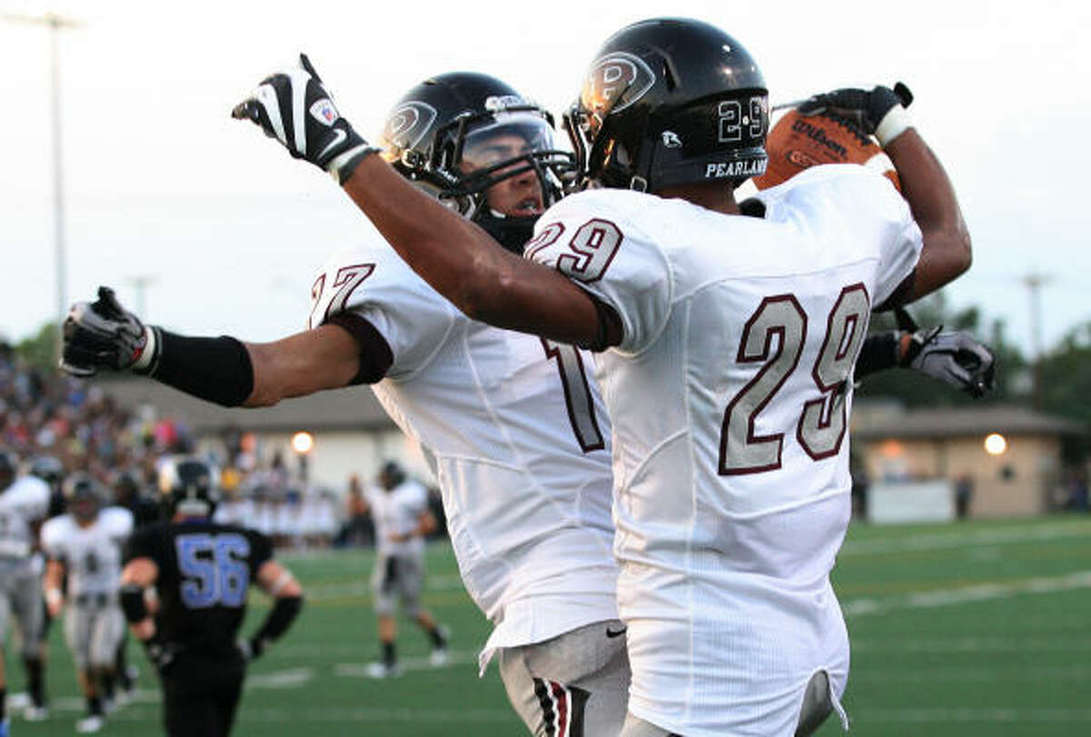 Sept. 25: Pearland vs. Clear Springs Pearland running back Dustin Garrison (29) celebrates with teammate Vincent Ortize after catching a touchdown pass in the first half of Saturday's game at Veterans Memorial Stadium in League City.