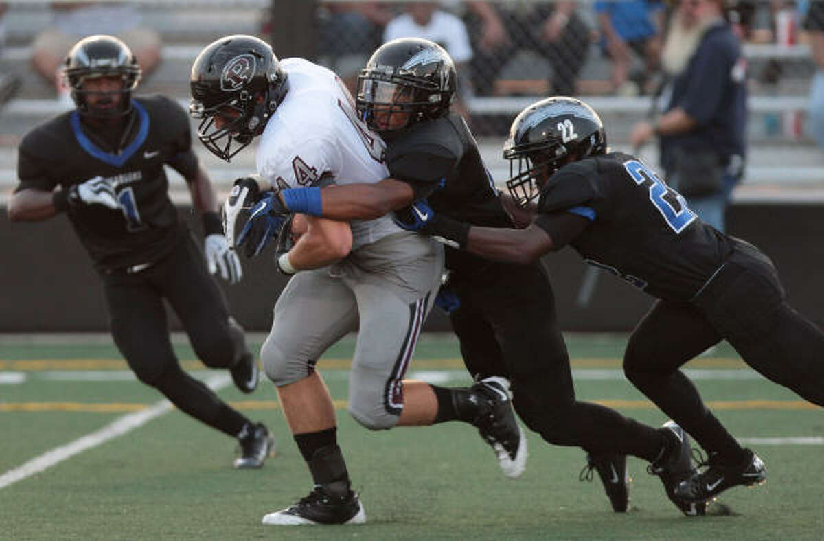 Pearland Tight end Cole Staudt is ganged tackled by the Clear Springs defense in the first half.