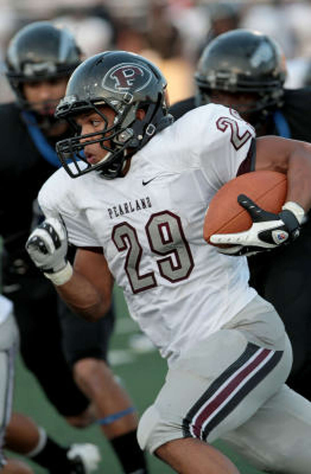 Pearland running back Dustin Garrison tries to find the corner on this carry.
