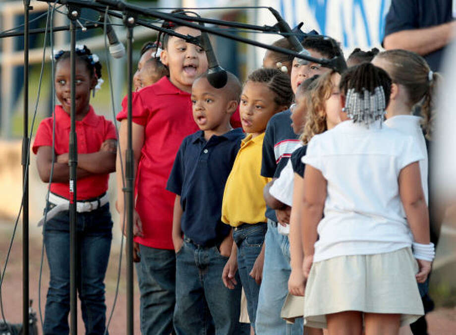 Students from Early Childhood Learning Center of La Marque ISD sing the National Anthem before Friday's game between La Marque and Manvel. Photo: Thomas B. Shea, For The Chronicle