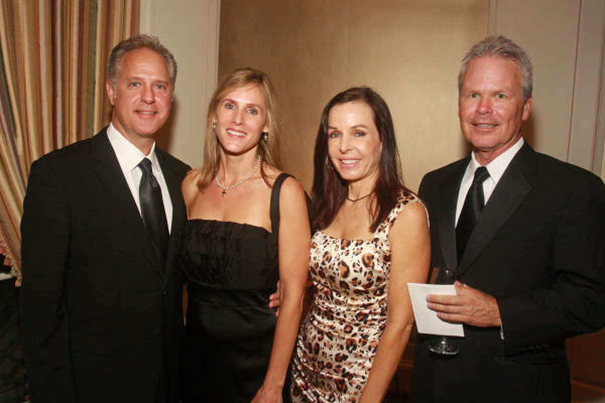 Mark Thomas, from left, Cindy Graham, Terry Graham and Patrick Henry at