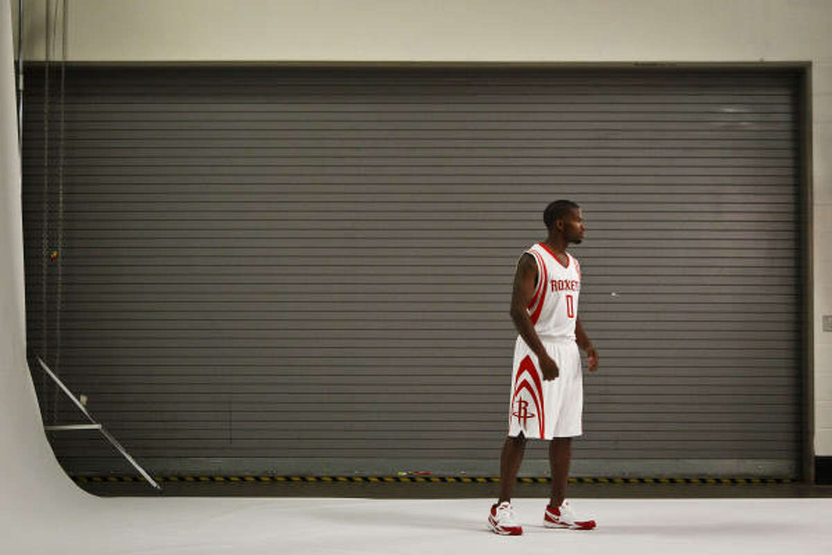 Aaron Brooks poses for a photo for the Rockets' team photographer.