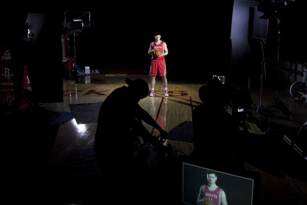 Yao Ming poses for a video clip during Rockets Media Day.