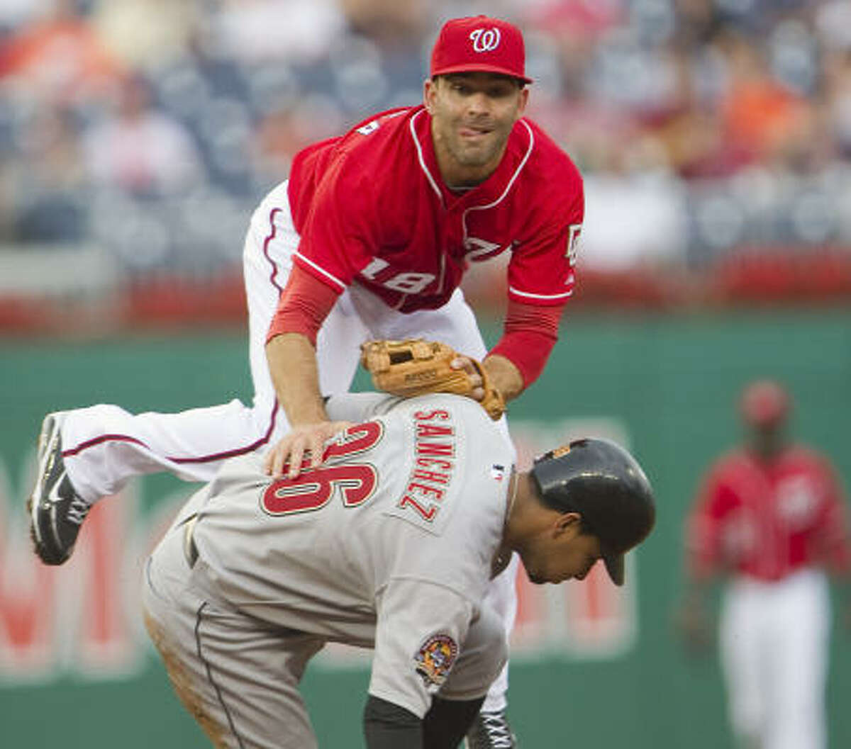 Sept. 23: Nationals 7, Astros 2 Astros shortstop Angel Sanchez slides into Nationals second baseman Danny Espinosa as Espinosa turns a double play to end the second inning.