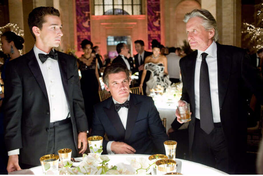 Jake (Shia LaBeouf, left), powerful investment banker Bretton James (Josh Brolin), and once-legendary Wall Street titan Gordon Gekko (Michael Douglas) in Wall Street 2: Money Never Sleeps (2010). Photo: Barry Wetcher SMPSP
