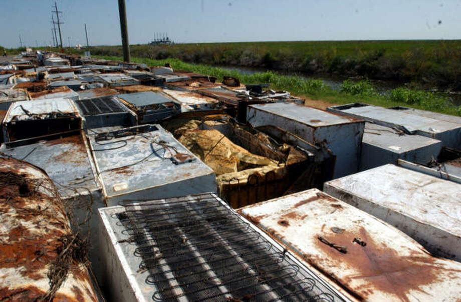 Approximately 368 refrigerators and iceboxes picked up from the Sabine National Wildlife Refuge lay waiting to be drained of their hazardous waste and disposed at a site designated for hazardous materials on Wednesday in Hackberry, La. Photo: ANDREW NENQUE, The Beaumont Enterprise