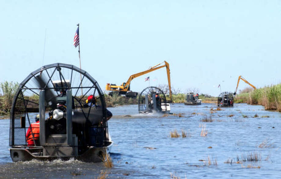 Airboats escort media guests on a tour down a canal at the Sabine National Wildlife Refuge on Wednesday. Photo: ANDREW NENQUE, The Beaumont Enterprise