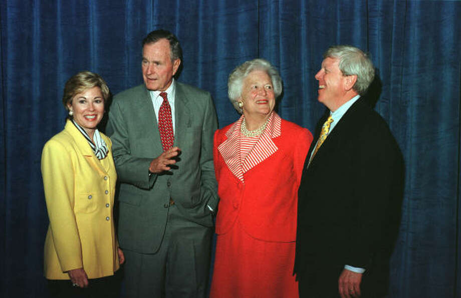 Rich and Nancy Kinder are shown with former President George and Barbara Bush in 1998. Kinder ranks No. 51 in this year's list. Photo: Melissa Mahan, Houston Chronicle