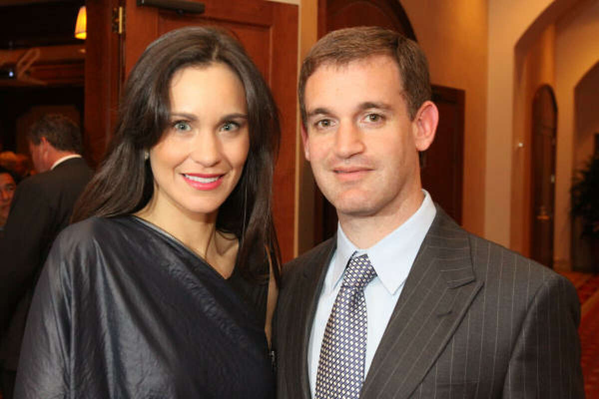 Laura and John Arnold attend the Houston Food Bank Gala. Arnold ranks No. 95.