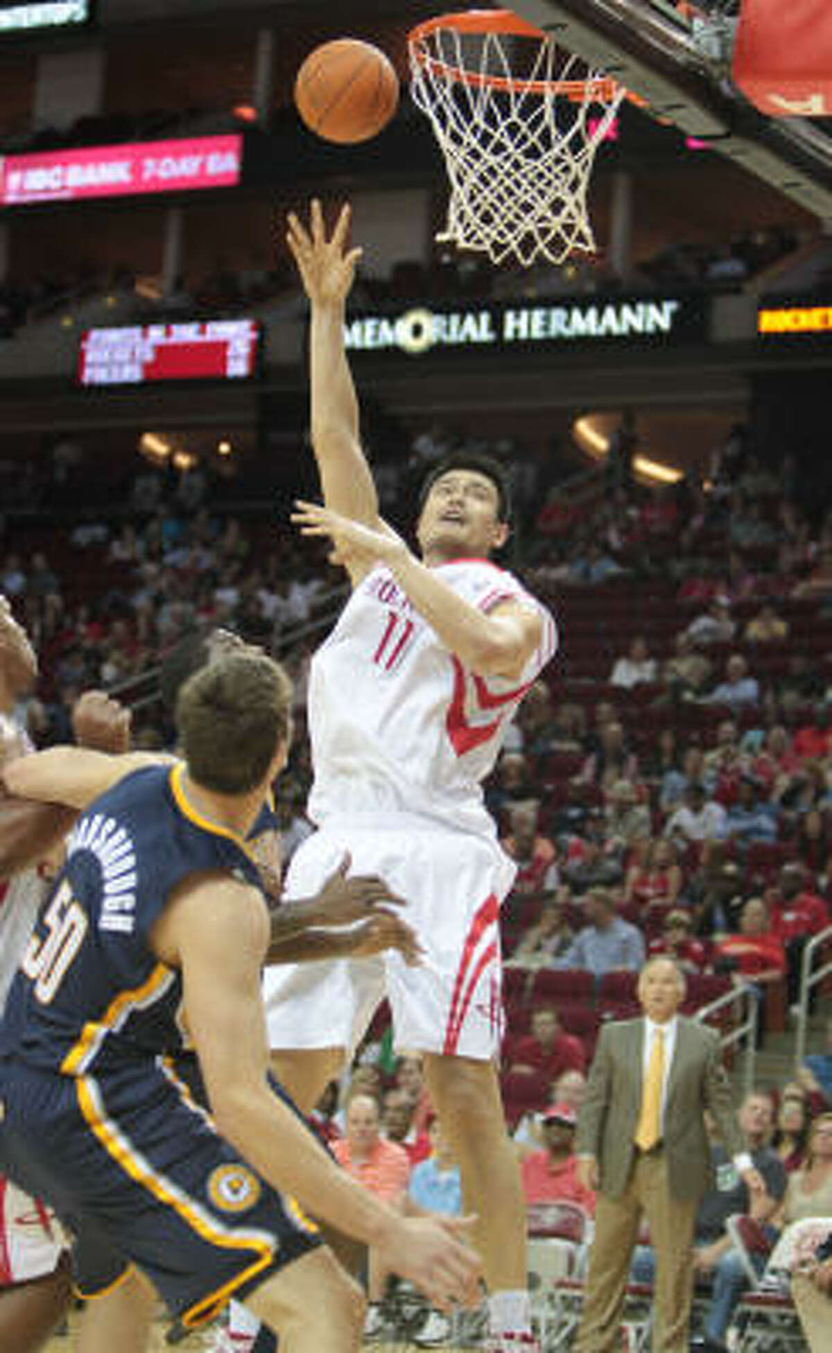 Yao Ming scored 10 points, grabbed four boards and had two blocks in 12 minutes of action on Saturday night.