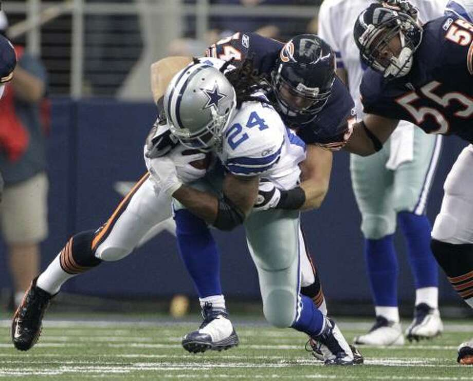 Sept. 19: Bears 27, Cowboys 20Bears linebacker Brian Urlacher brings down Cowboys running back Marion Barber. Photo: Tony Gutierrez, AP