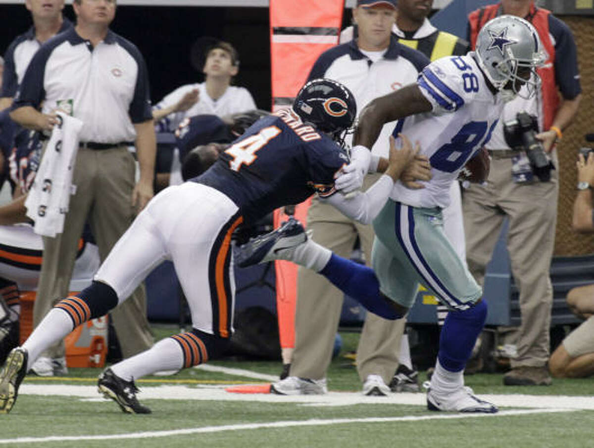 Cowboys receiver Dez Bryant runs past Bears punter Brad Maynard as he returns a punt for a touchdown.