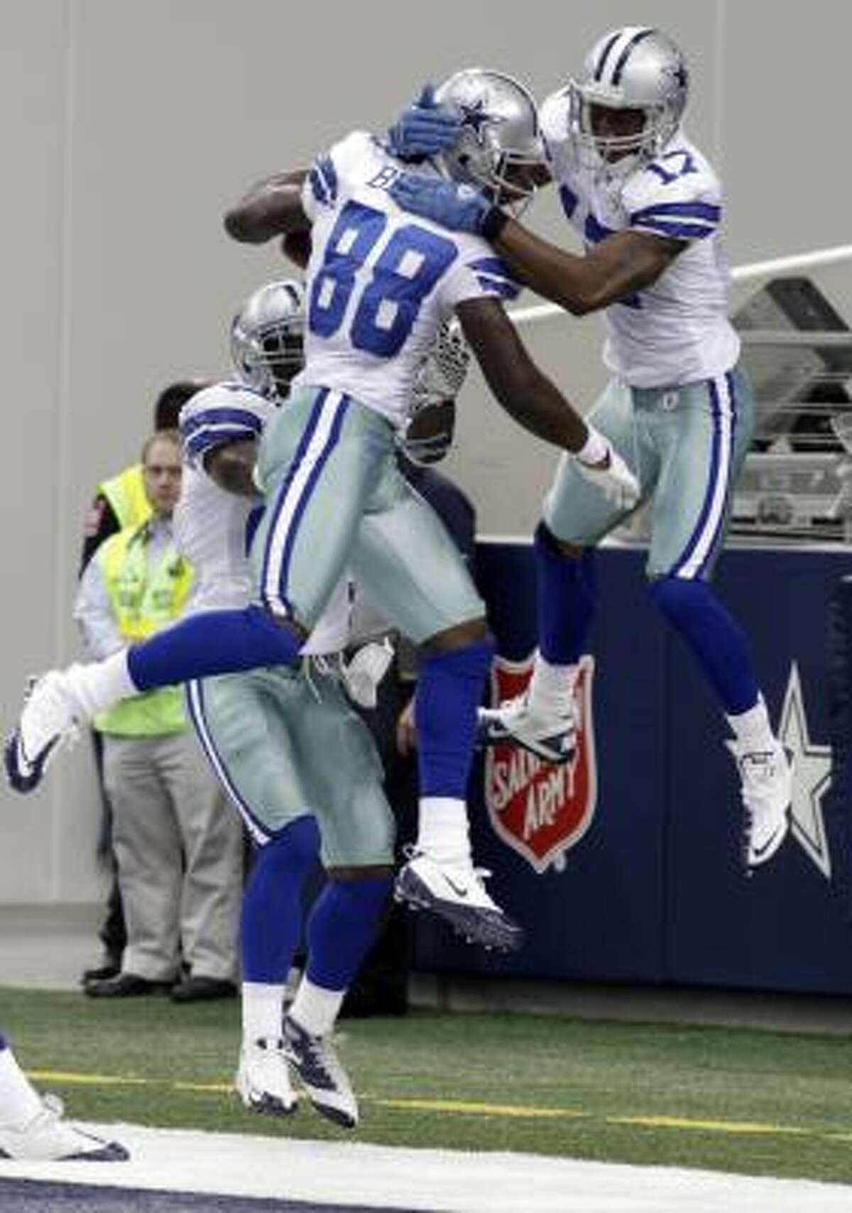 Cowboys wide receiver Dez Bryant celebrates his touchdown with wide receiver Sam Hurd.