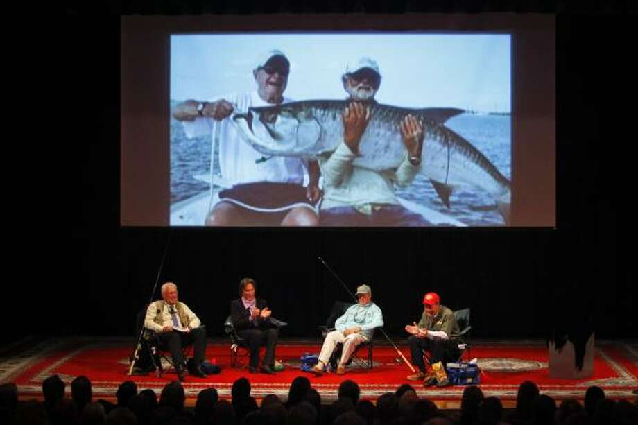 From left, Robert Rich Jr., a writer and fisherman; Andy Mill, a tarpon angler; Paul Dixon of the Anglers Club of New York; and Johnny Morris, founder of Bass Pro Shops, share fishing stories as a photograph of former President, George H. W. Bush, is displayed with a tarpon. Photo: Michael Paulsen, Houston Chronicle