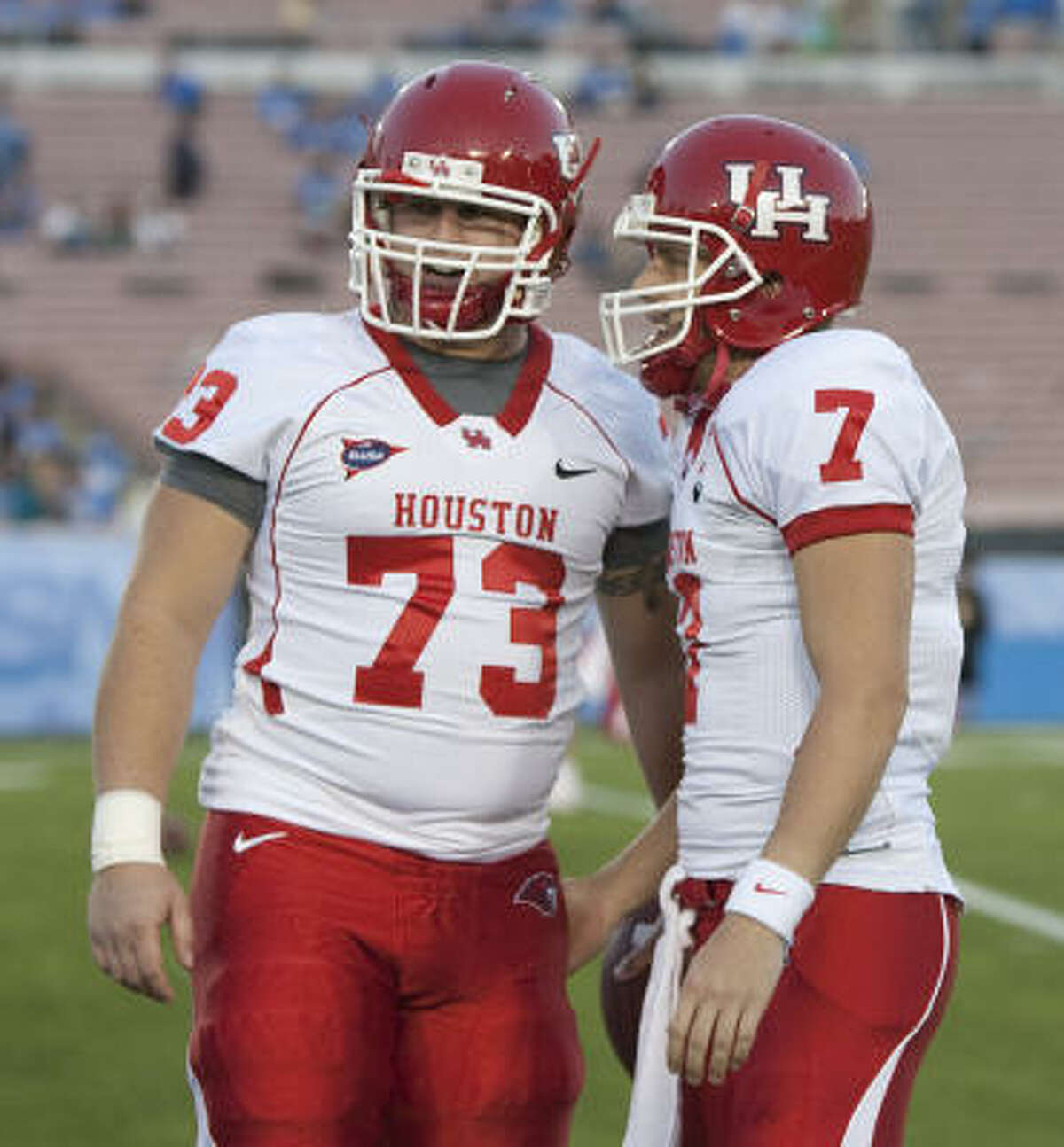 Houston offensive linesman Jordan Shoemaker (73) and Houston quarterback Case Keenum (7) talk as they warm up for the game.