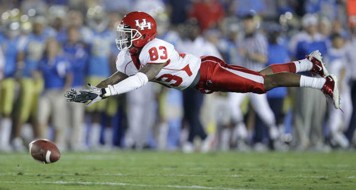 Houston wide receiver Patrick Edwards (83) can't hold on to the ball.