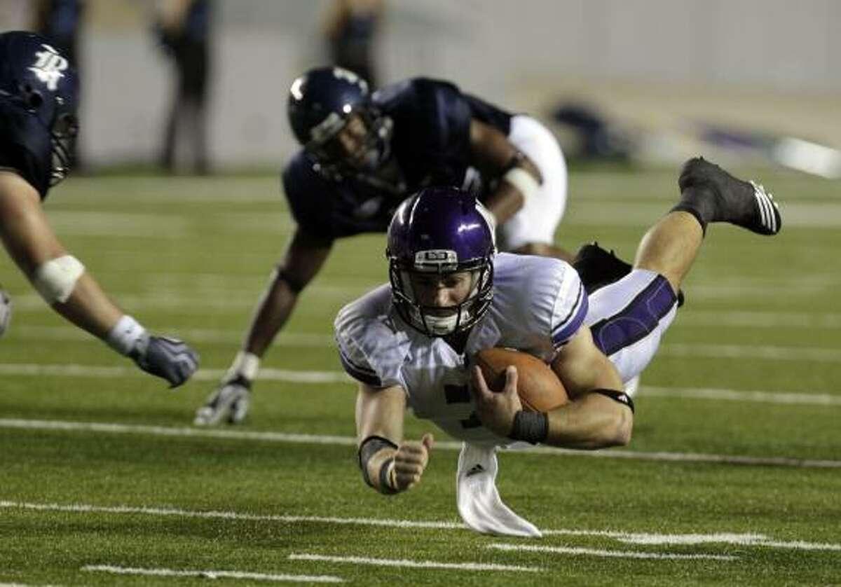 Sept. 18: Northwestern 30, Rice 13 Northwestern quarterback Dan Persa dives for a gain of six yards in the third quarter.