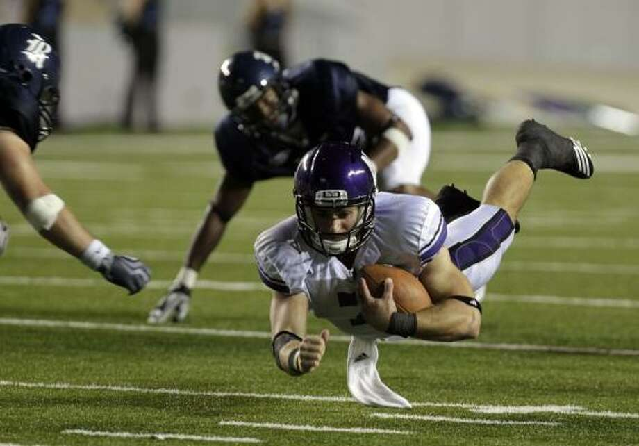 Sept. 18: Northwestern 30, Rice 13Northwestern quarterback Dan Persa dives for a gain of six yards in the third quarter. Photo: Johnny Hanson, Chronicle