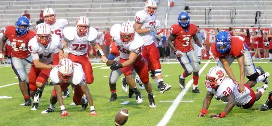 "Sept. 18: Katy 45, Beaumont West Brook 21Katy and West Brook scramble for a fumbled ball during Saturday night's game at the Carrol ""A"" Butch Thomas Educational Support Center in Beaumont. Photo: TAMMY MCKINLEY, The Beaumont Enterprise"