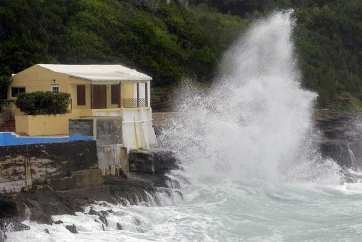 A wave crashes against the rocks in Smith's Parish as Hurricane Igor approaches in Bermuda. The National Hurricane Center in Miami said tropical storm winds will start battering Bermuda Saturday night, with the hurricane expected to pass near Bermuda early Monday.