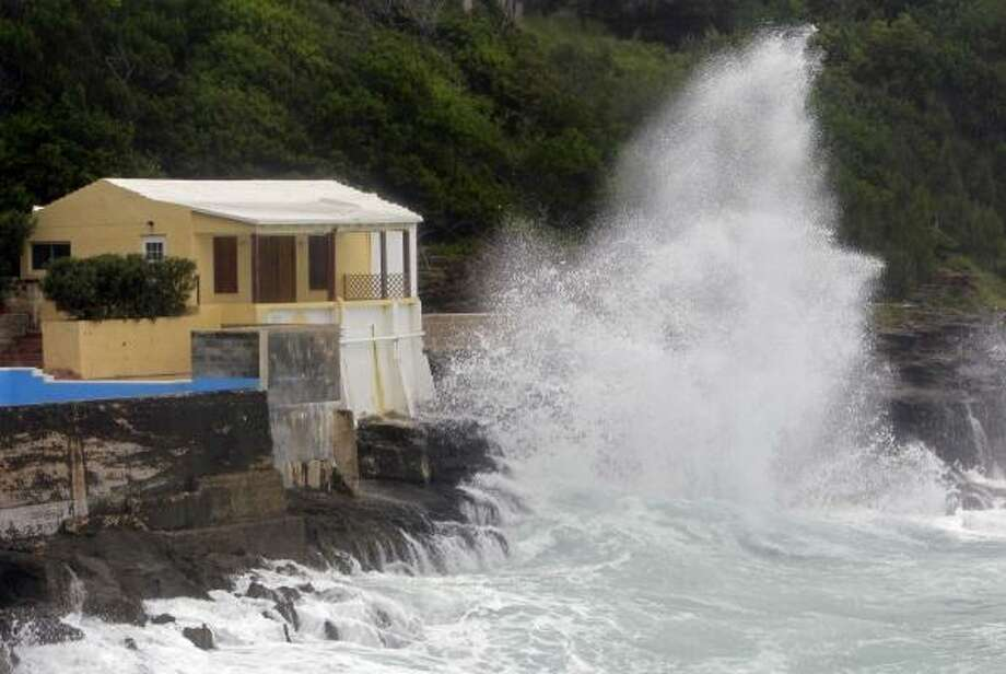 A wave crashes against the rocks in Smith's Parish as Hurricane Igor approaches in Bermuda. The National Hurricane Center in Miami said tropical storm winds will start battering Bermuda Saturday night, with the hurricane expected to pass near Bermuda early Monday. Photo: Gerry Broome, AP