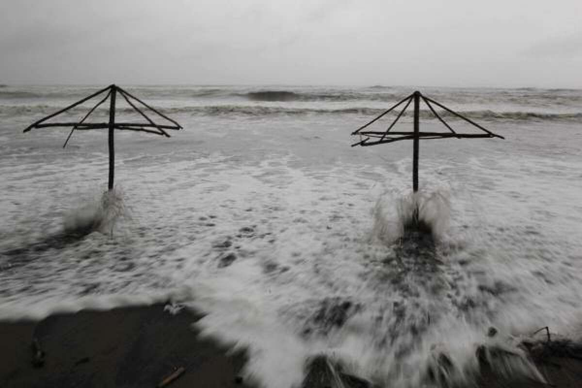 Sea waves hit sunshades at Maracaibo beach in Nautla, in the state of Veracruz, Mexico. Hurricane Karl, that reached Category 3 strength in the Gulf of Mexico, is expected to reach the country's central coast Friday.