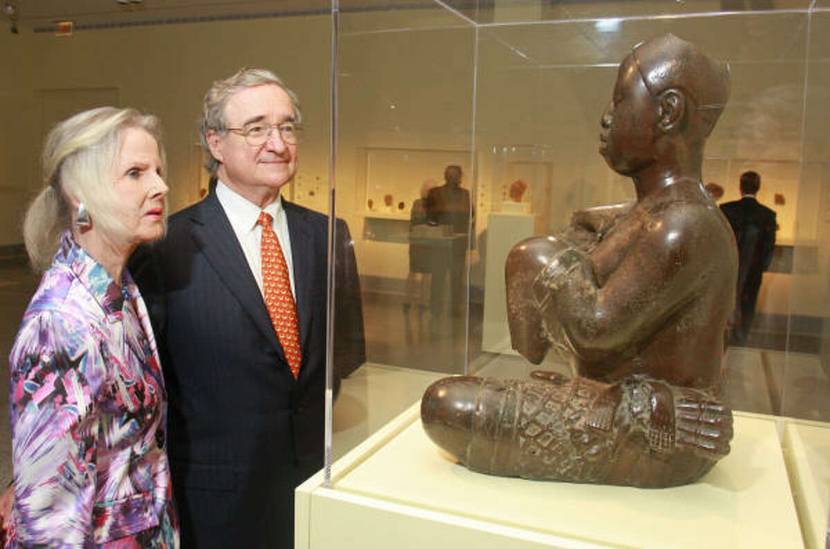 Macey and Harry Reasoner view an Ife sculpture during a private reception for a Museum of Fine Arts, Houston patrons dinner celebrating the opening of Dynasty and Divinity: Ife Art in Ancient Nigeria.
